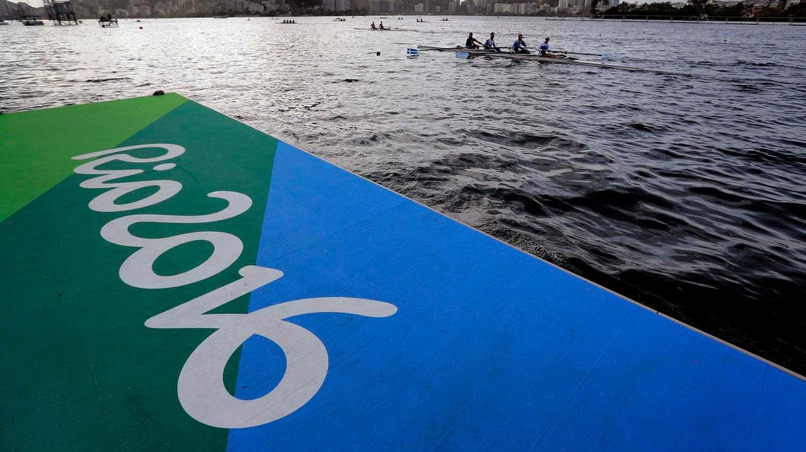 Athletes warm up during rowing team practices in Lagoa ahead of the 2016 Summer Olympics in Rio de Janeiro, Brazil. (AP)