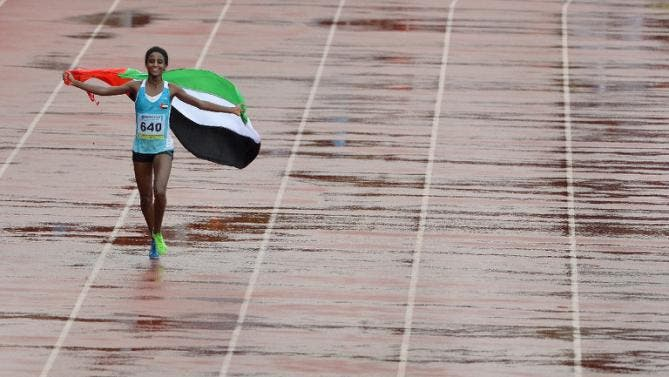 UAE's Betlhem Desalegn makes her victory lap on the fifth and the final day of Asian Athletics Championship 2013 in Pune on July 7, 2013. (AFP)
