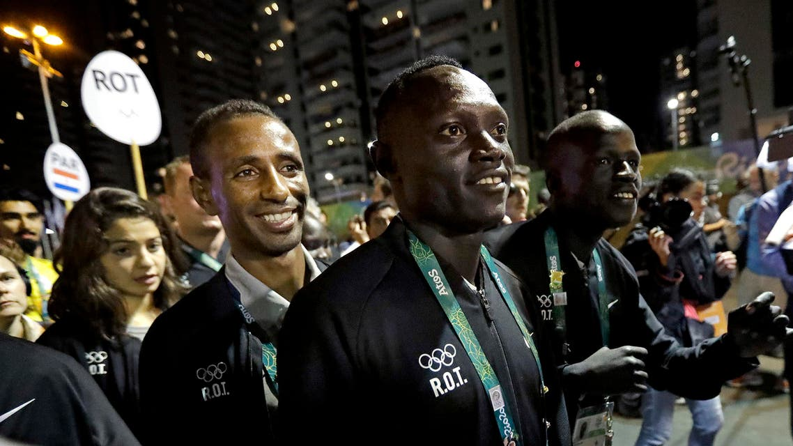 Members of the Refugee Olympic Team watch a welcoming ceremony at the Olympic athletes village in Rio de Janeiro, Brazil, Wednesday (Photo: AP)