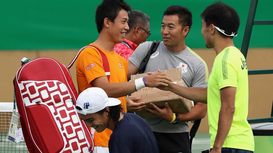 Kei Nishikori of Team Japan walks on the practice court at the Olympic Tennis Center in Rio de Janeiro (Photo: AFP)