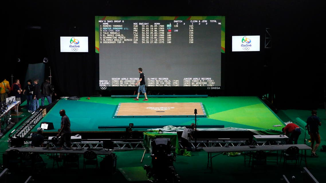 Workers prepare for the weightlifting competitions (Photo: AP)