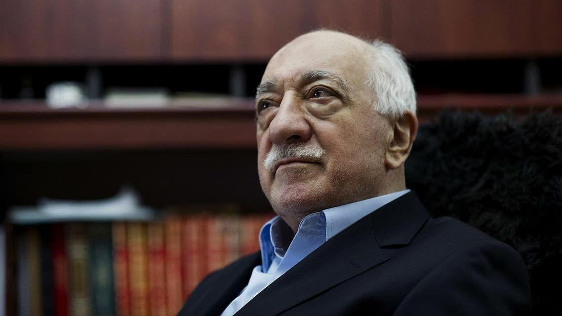 In this March 15, 2014 file photo, Turkish Muslim cleric Fethullah Gulen, sits at his residence in Saylorsburg, Pa.In a dispute between NATO allies, Turkey demands that the United States extradite Fethullah Gulen, a Pennsylvania-based Turkish cleric, to face charges of engineering a coup attempt. But despite indications that his followers were behind the failed military uprising, analysts say concerns about whether Gulen could get a fair trial complicate Turkey's bid. (AP Photo/Selahattin Sevi, File)