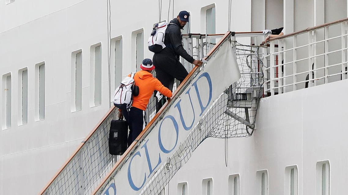 DeMarcus Cousins, center right, and Carmelo Anthony of the United States men's basketball team, board the Silver Cloud cruise ship in Brazil (Photo: AP)