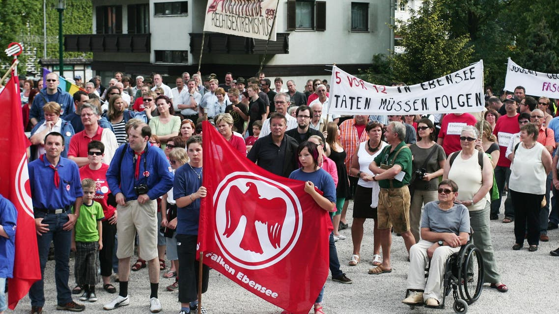 """rotesters with banners are seen during a demonstration """"Against right-wing extremism - Pro tolerance, moral courage, anti racism and democracy"""" on Sunday, May 24, 2009 in Ebensee, Austria. (AP"""