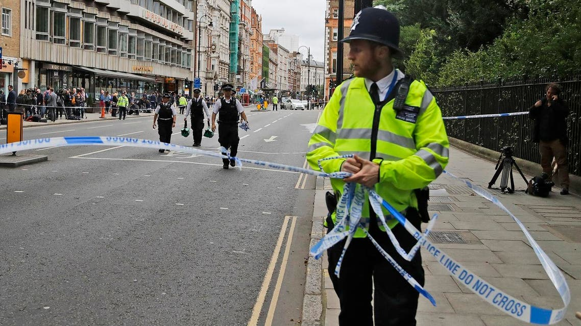 Police forces clear police tape off Russel Square in London, Thursday, Aug. 4, 2016. Terrorism is being examined as a potential motive for a knife rampage at Russell Square, central London, that left one woman dead and five others injured. (AP Photo/Frank Augstein)