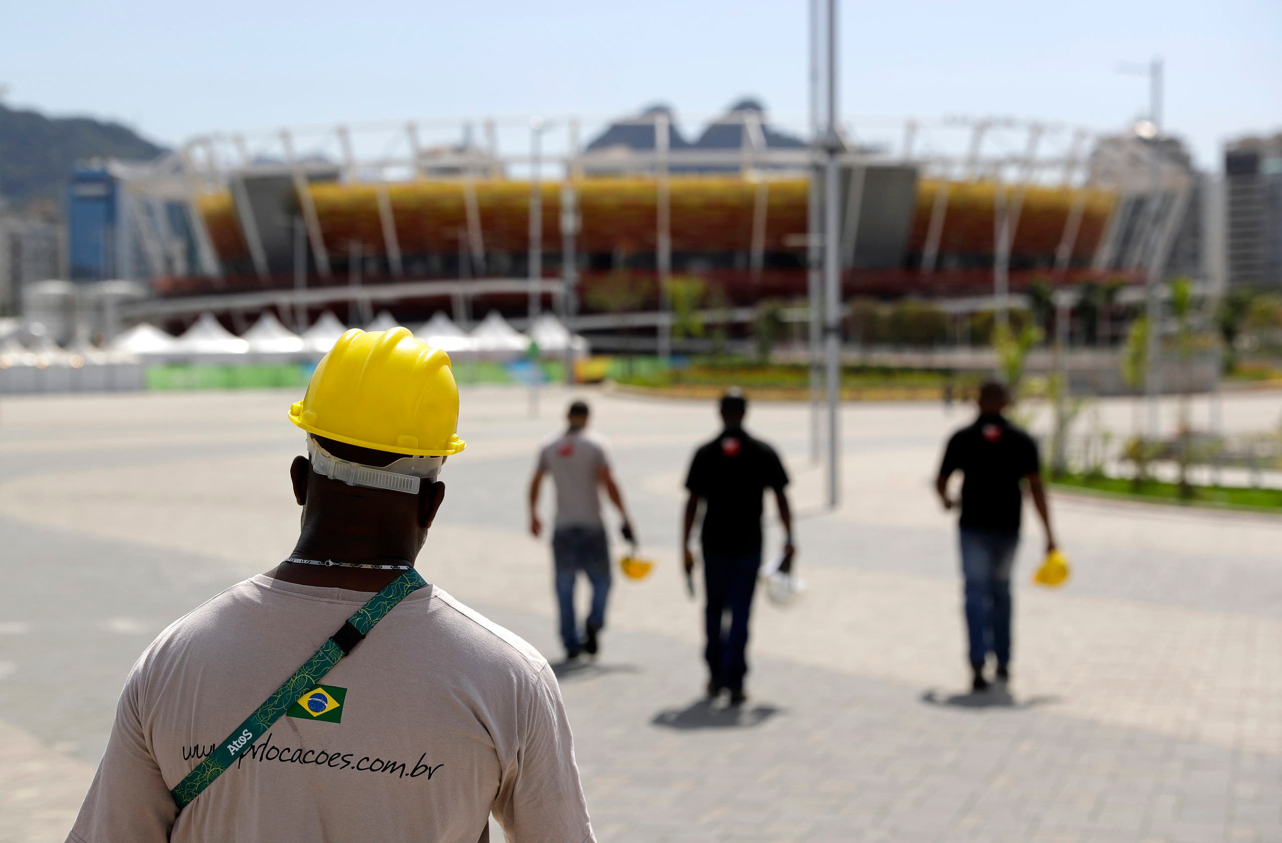 Construction workers walk inside Olympic Park as preparations take place for the 2016 Rio de Janeiro Games in Rio de Janeiro, Brazil, Wednesday, July 27, 2016. (AP)