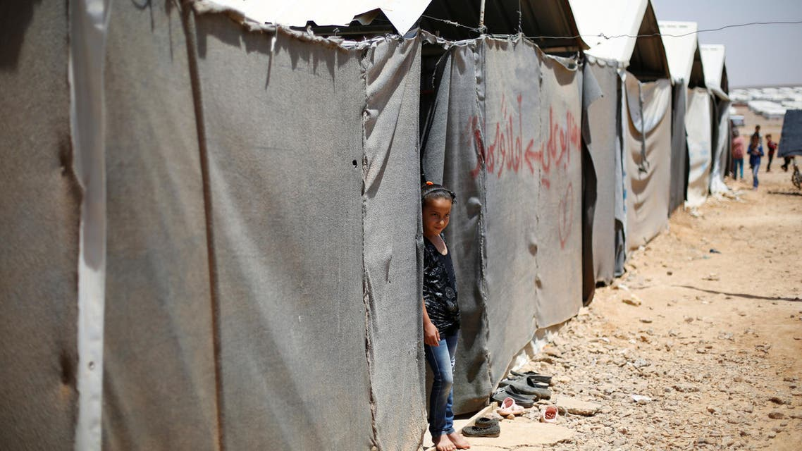 A Syrian refugee girl stands in front of her family residence at Azraq refugee camp near Al Azraq city, Jordan, June 27, 2016. REUTERS/