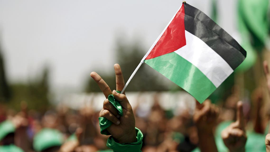 A student supporting Hamas holds a Palestinian flag in a rally during an election campaign for the student council at the Birzeit University in the West Bank city of Ramallah April 26, 2016. REUTERS