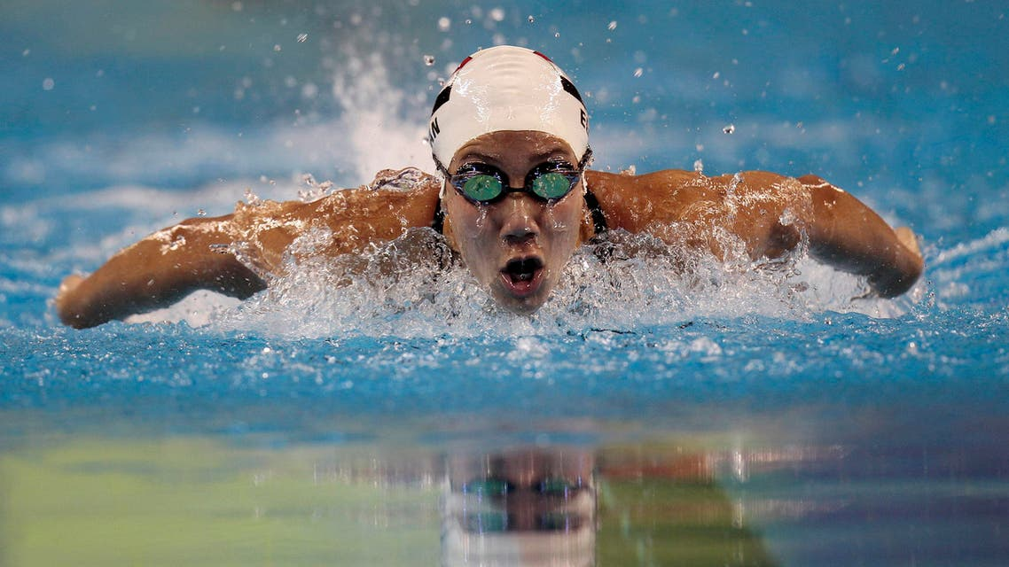 Farida Osman of Egypt swims during the women's 100m butterfly final at the Arab Games in Doha December 17, 2011. REUTERS