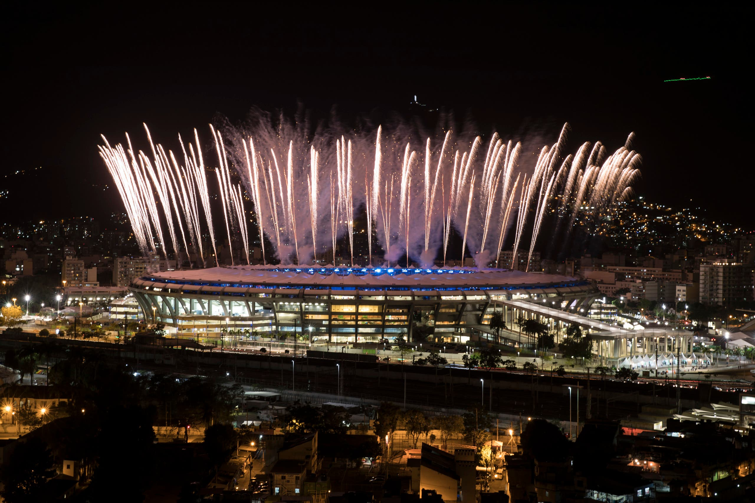 Fireworks explode above the Maracana stadium during the rehearsal of the opening ceremony of the Olympic Games in Rio de Janeiro, Brazil, Sunday, July 31, 2016. (AP