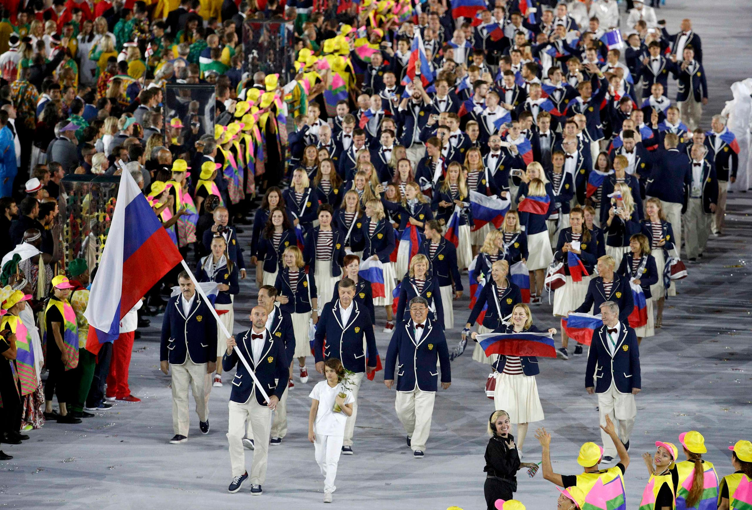 Flagbearer Sergey Tetyukhin (RUS) of Russia leads his contingent during the opening ceremony. REUTERS