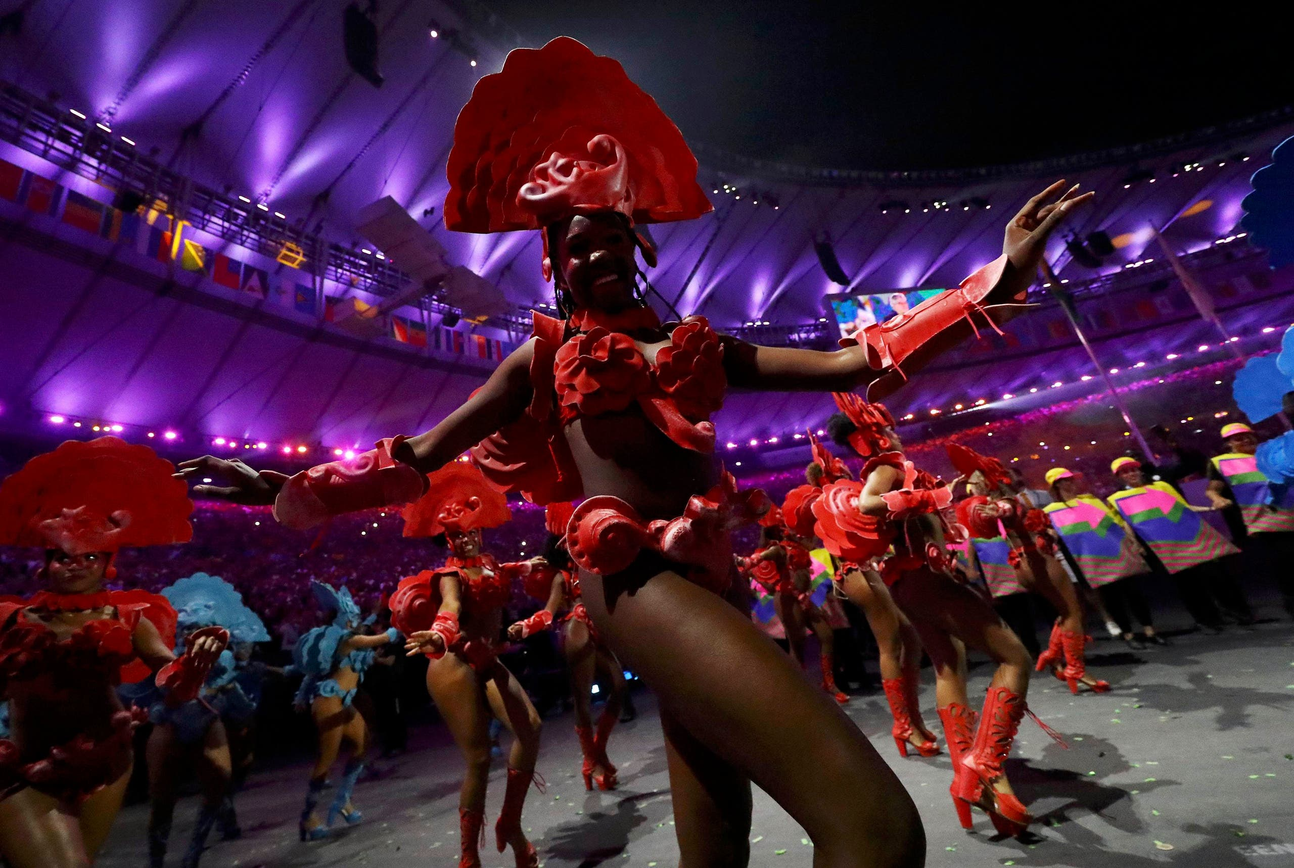 Performers take part in the opening ceremony. REUTERS