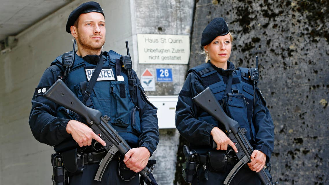 Police guards conference building before the Christian Social Union (CSU) meeting in Sankt Quirin, Germany July 26, 2016. REUTERS