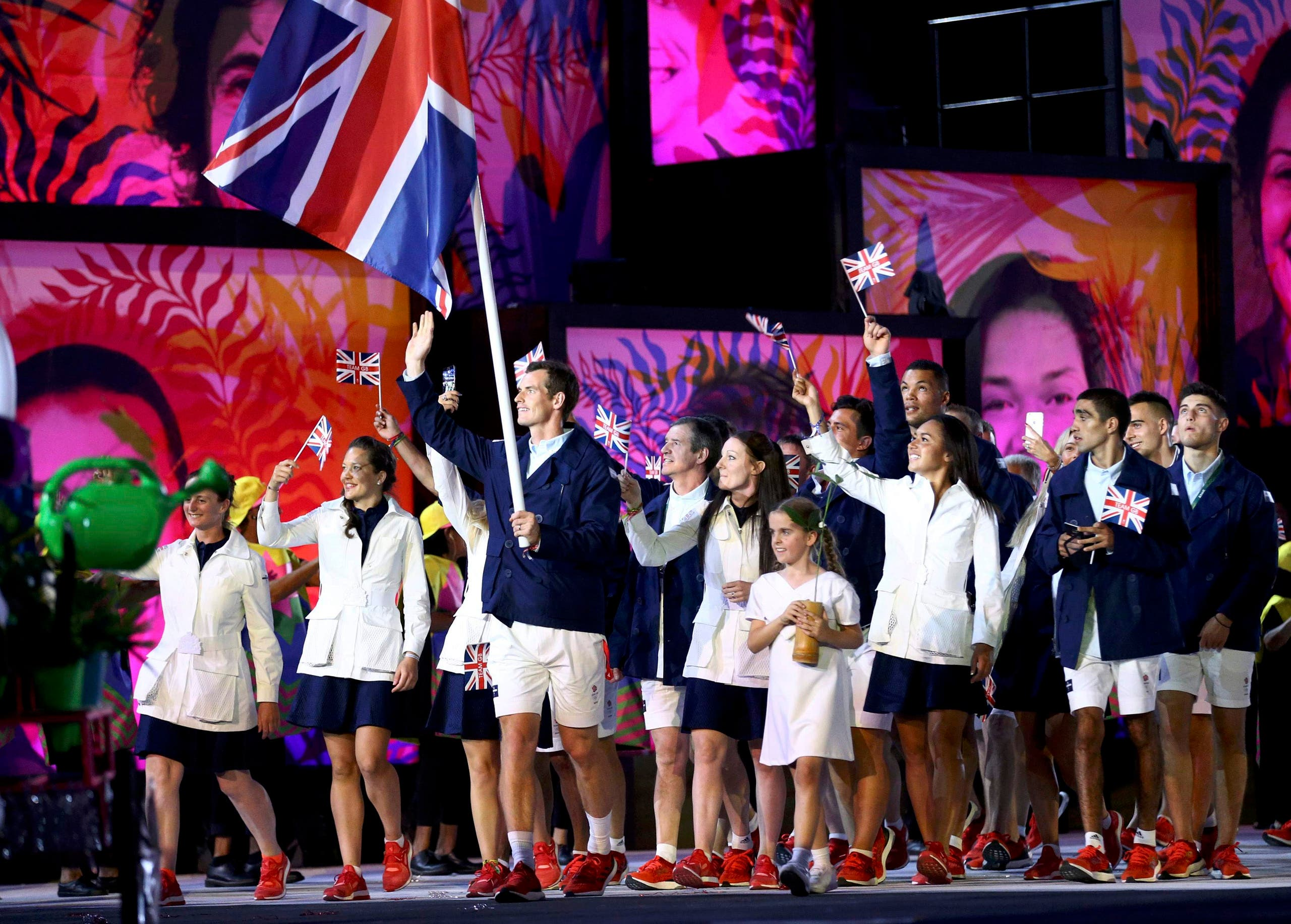 Flag-bearer Andy Murray (GBR) of Great Britain leads his contingent during the opening ceremony. REUTERS