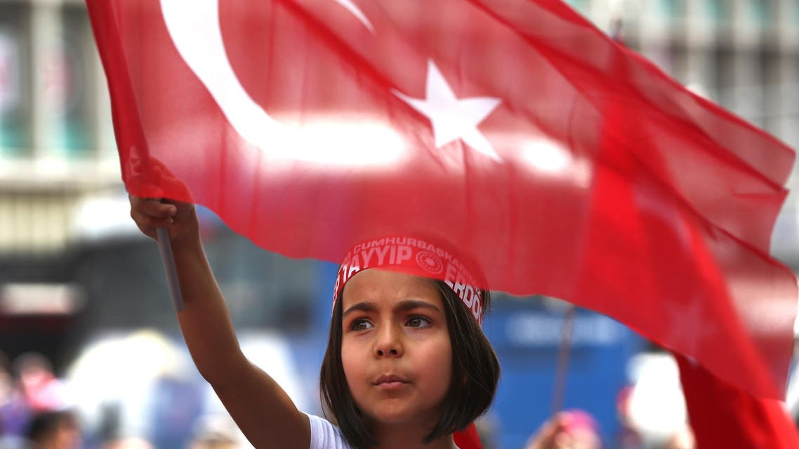 A Turkish girl wearing a headband bearing the name of Turkish president Recep Tayyip Erdogan waves her nation flags during a pro-government demonstration in front of the old parliament building, in Ankara, Turkey, Wednesday, July 20, 2016. The coup has led to public anger and calls for the government to reinstate capital punishment, while the state-run religious affairs body declared no religious rites would be performed for the coup plotters killed in the uprising. (AP)