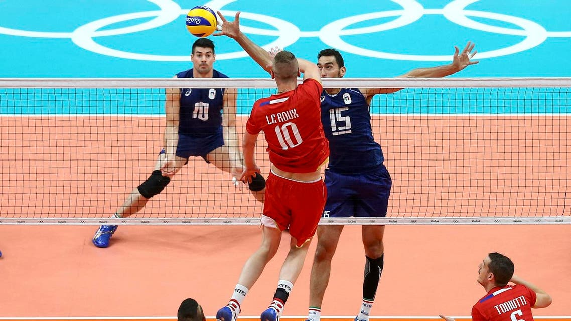 Kevin Le Roux of France spikes the ball against Emanuele Birarelli of Italy (Photo: Reuters)