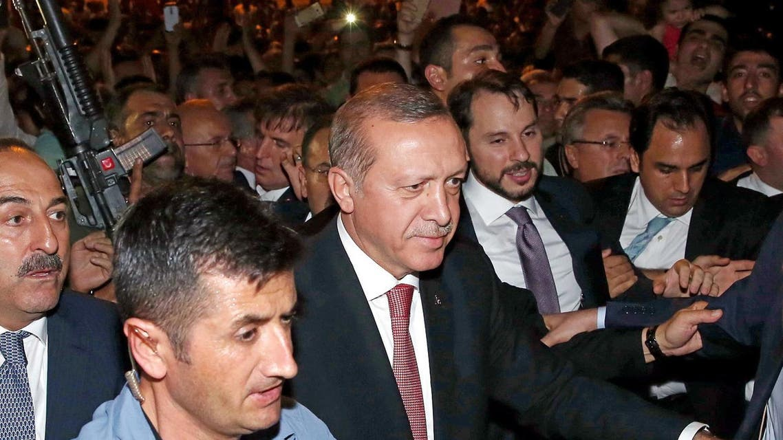 Turkey's President Recep Tayyip Erdogan, center, walks to greet people gathering outside of the Presidential Palace in Ankara, Turkey, Wednesday, Aug. 3. (Photo:AP)