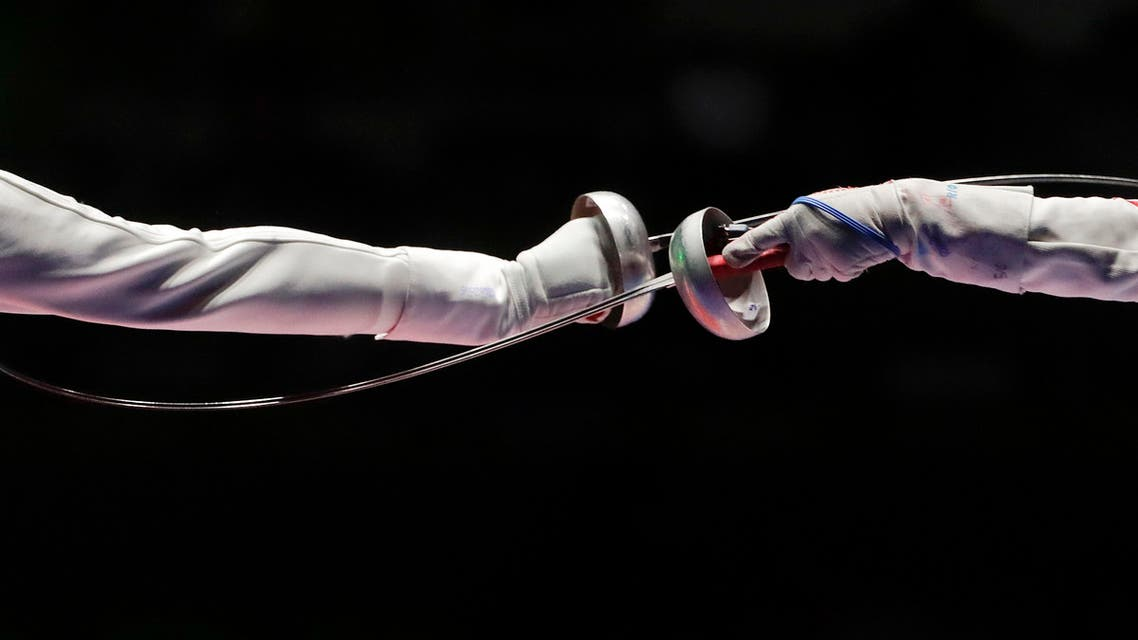 China's Sun Yiwen, right, compete against France's Lauren Rembi in the women's individual epee fencing bronze medal match (Photo: AP)