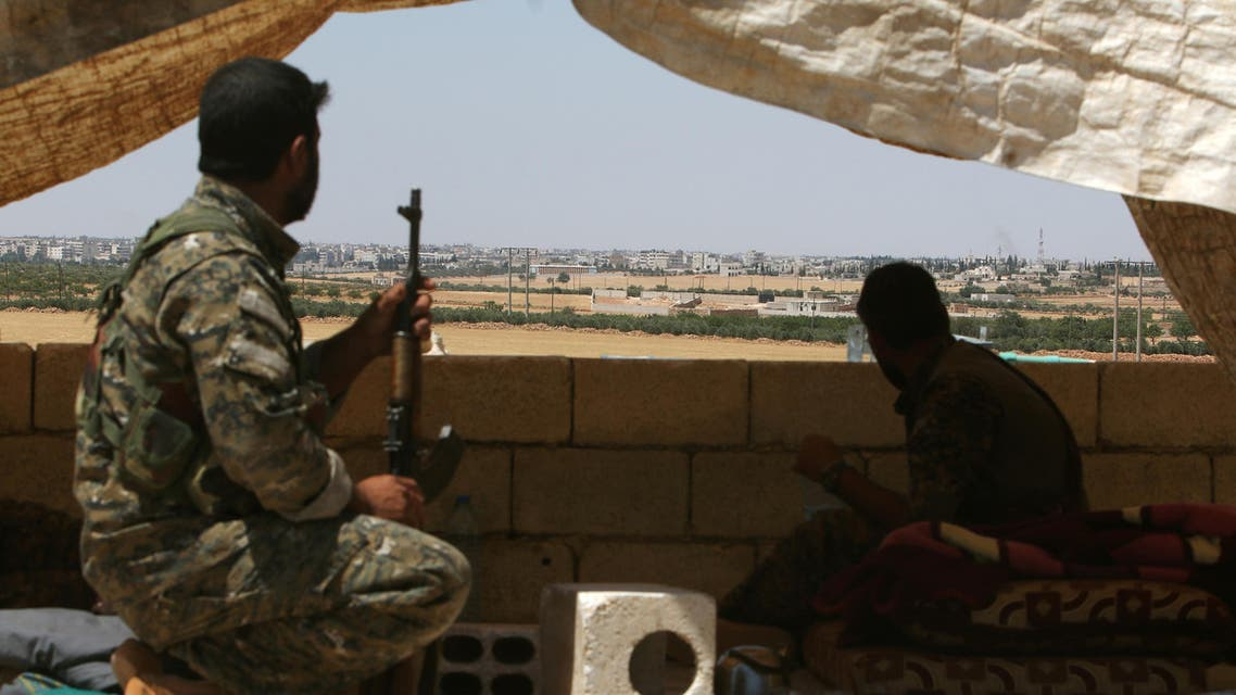 Fighters of the Syria Democratic Forces (SDF) sit in a look out position in the western rural area of Manbij, in Aleppo Governorate, Syria, June 13, 2016. REUTER