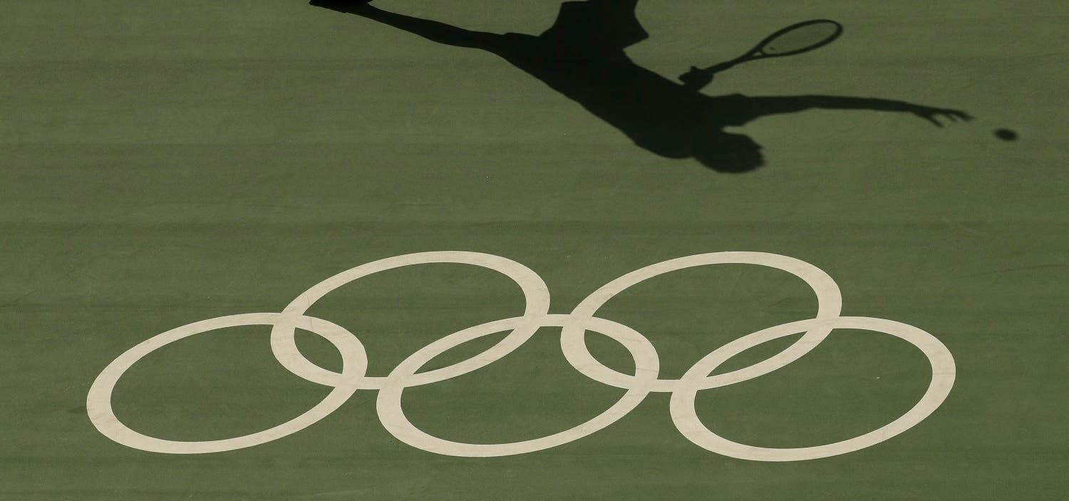 Tunisian tennis player Malek Jazira serves during a match against France's Jo-Wilfried Tsonga at the Olympic Park (Photo: AP)