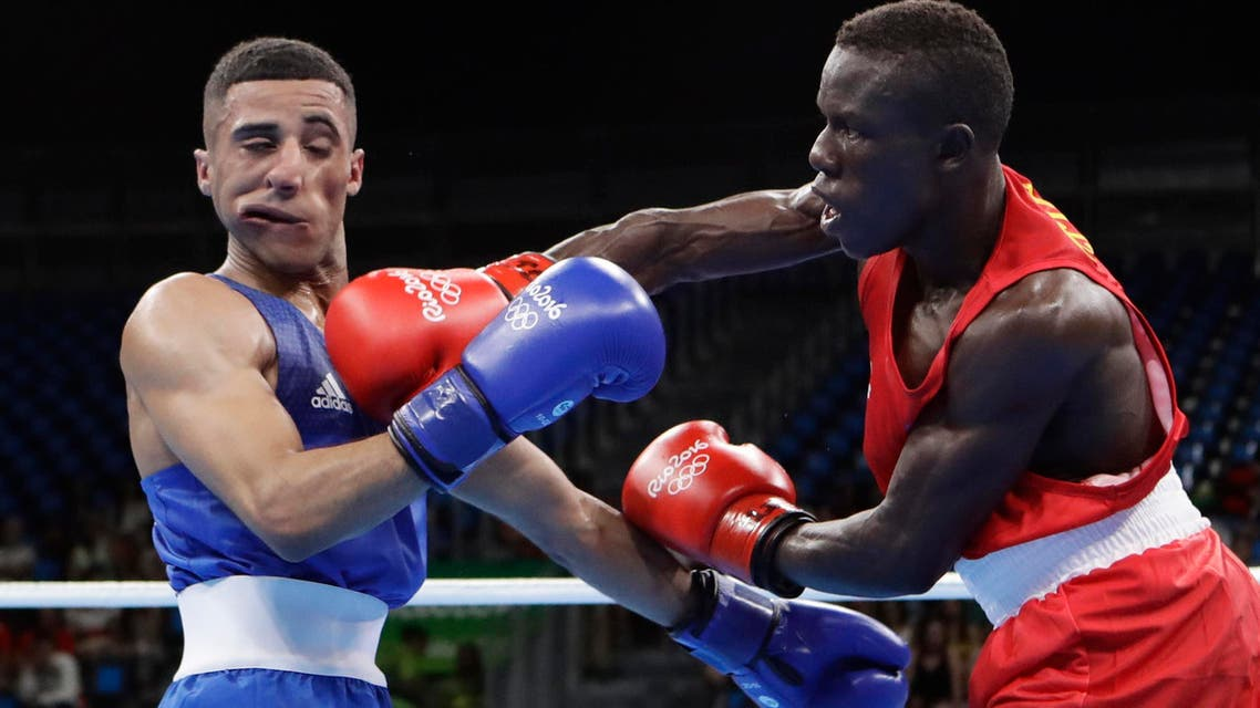 Cameroon's Simplice Fotsala, right, fights Britain's Galal Yafai during a men's light flyweight 49kg preliminary boxing match (Photo: AP)