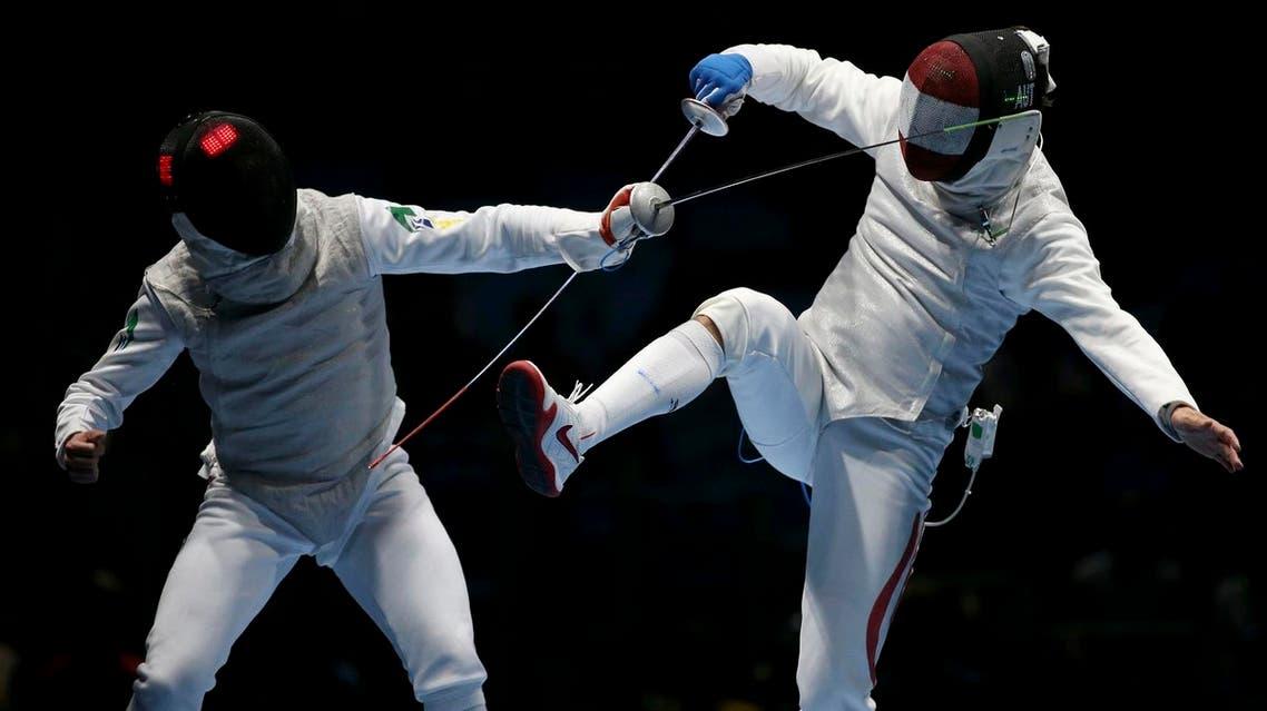 Guilherme Toldo of Brazil competes with Rene Pranz of Austria (Photo: AP)