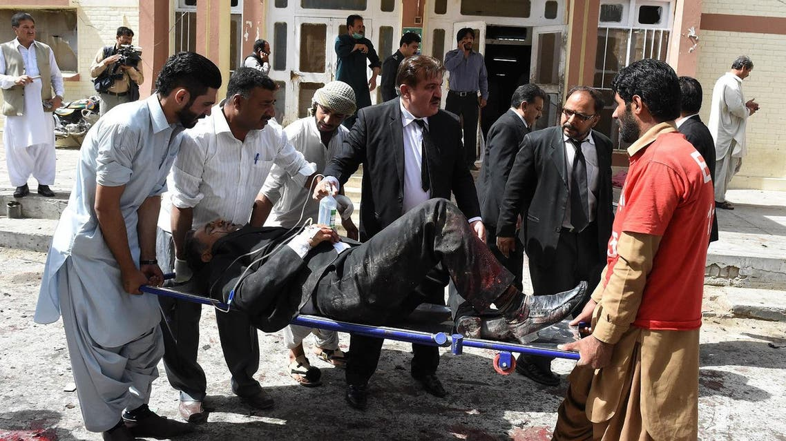Pakistani lawyers use a stretcher to move an injured colleague after a bomb explosion at a government hospital premises in Quetta. (AFP)