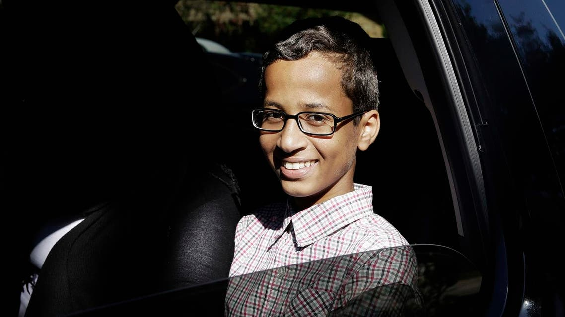 In this Sept. 17, 2015 file photo, Ahmed Mohamed sits in a vehicle before leaving his family's home in Irving, Texas. The family of Ahmed Mohamed, who was arrested after a homemade clock he brought to school was mistaken for a bomb, filed a lawsuit Monday, Aug. 8, 2016, against Texas school officials saying they violated the boy's civil rights. (AP Photo/LM Otero, File)  Use Information This conte