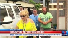 Australian man charged with planning terror attack following raids