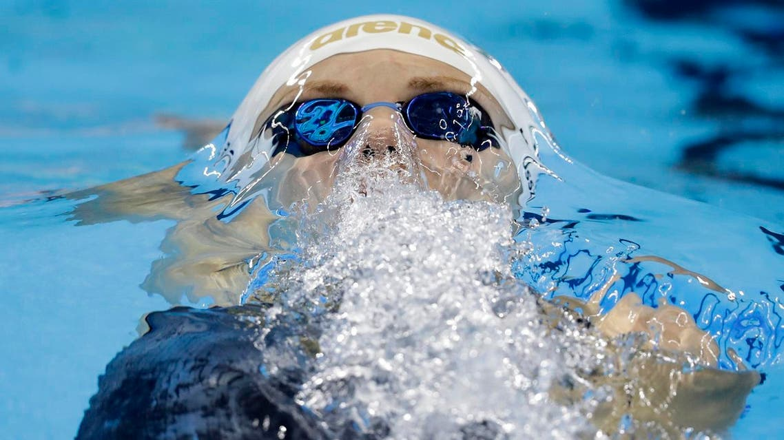 Hungary's Katinka Hosszu competes in a women's 100-meter backstroke heat during the swimming competitions at the 2016 Summer Olympics, Sunday, Aug. 7, 2016, in Rio de Janeiro, Brazil. (AP Photo/Michael Sohn)