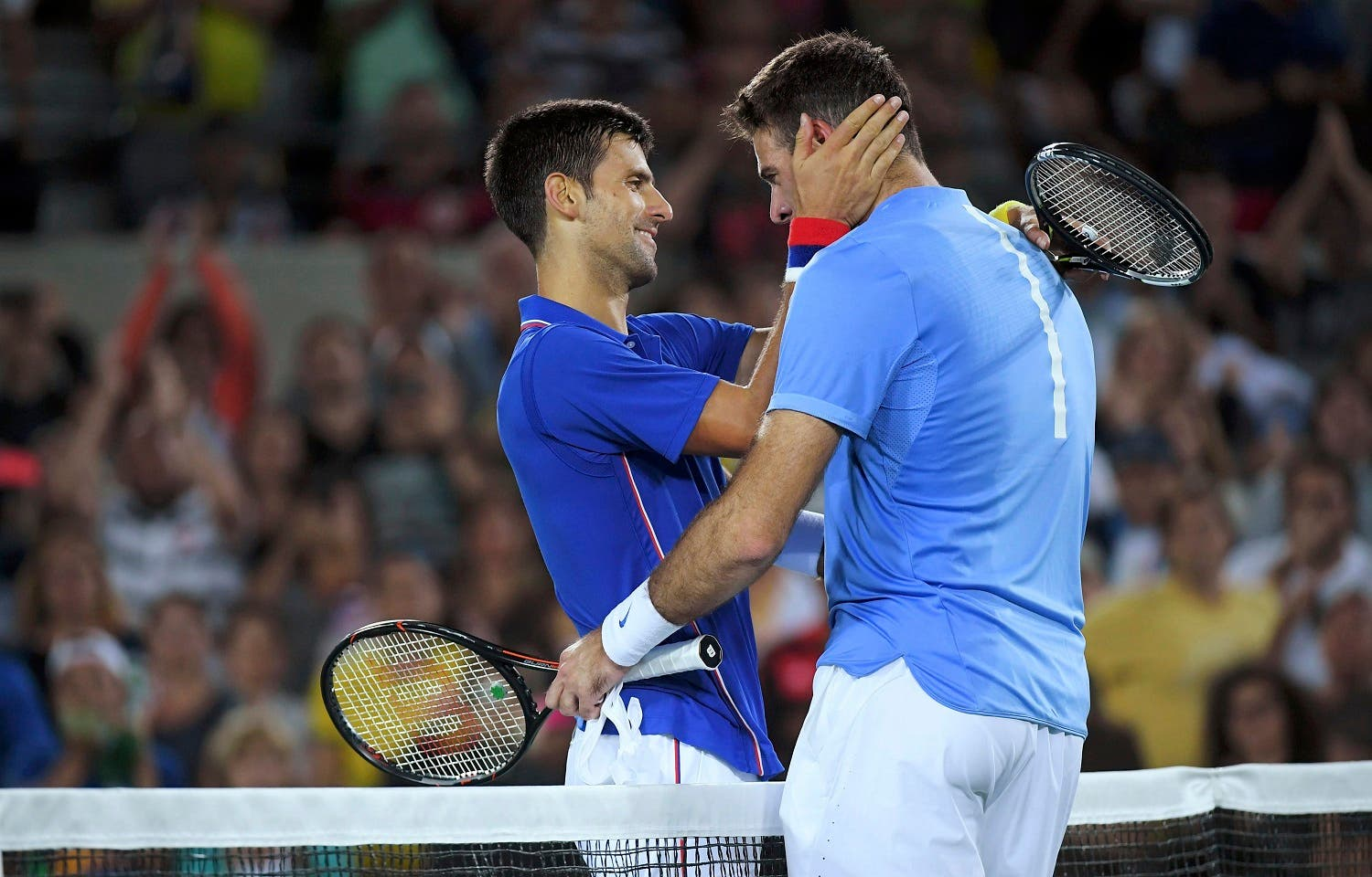 Both players embraced at the net and wept at the end of their centre court duel, played out in front of a raucous Argentine and Serb crowd. (Reuters)