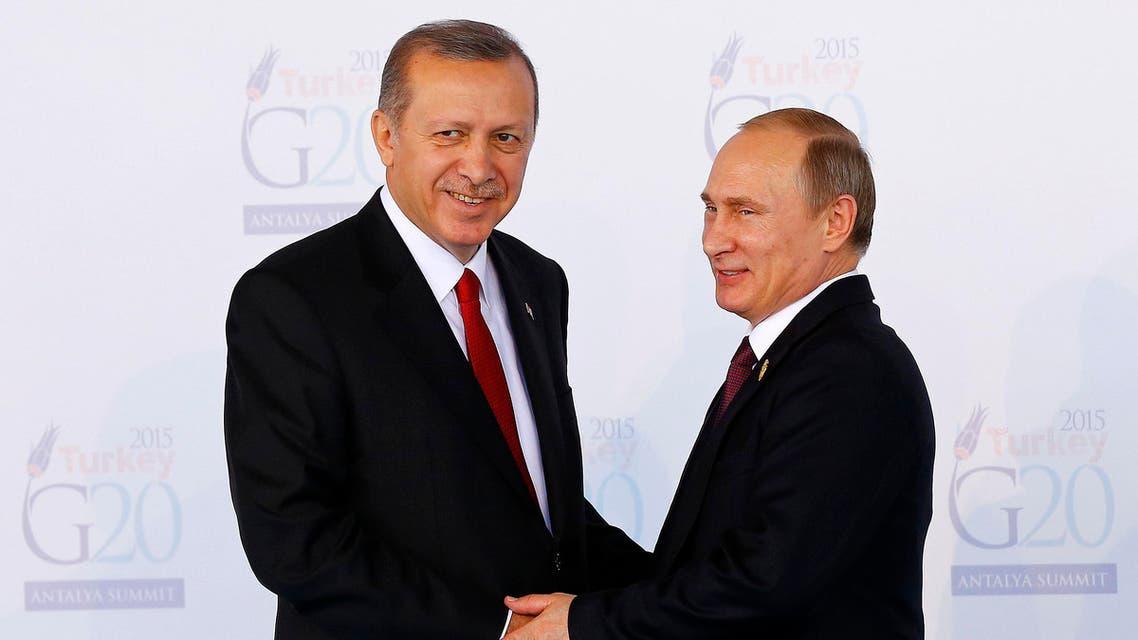 This file photo taken on November 15, 2015 shows Turkish President Recep Tayyip Erdogan (L) greeting Russian President Vladimir Putin (R). (AFP)