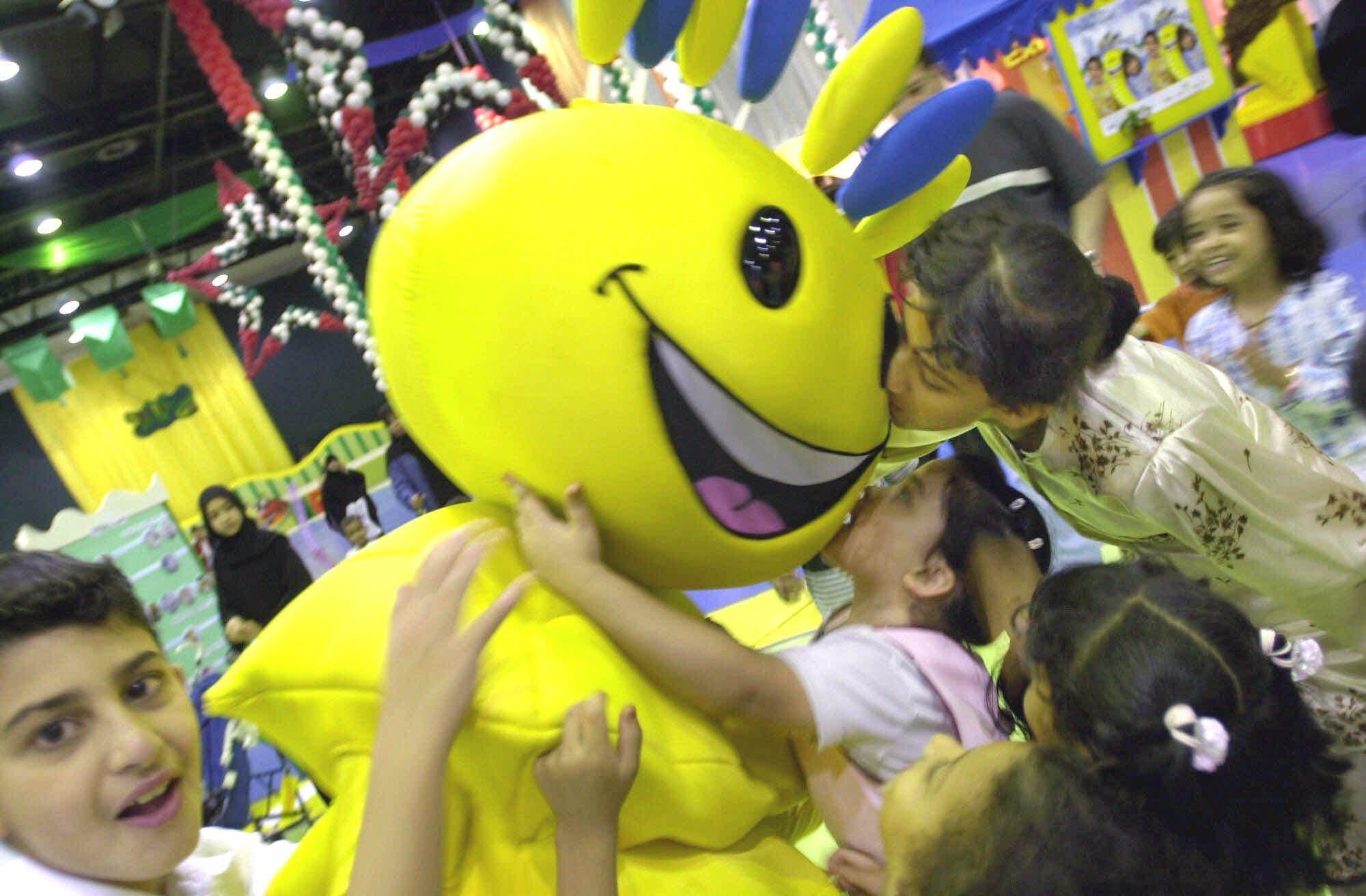 Arab children playing with Modhesh, the cartoon character at the Modhesh Fun City during Dubai Summer Surprises (File photo: AP)