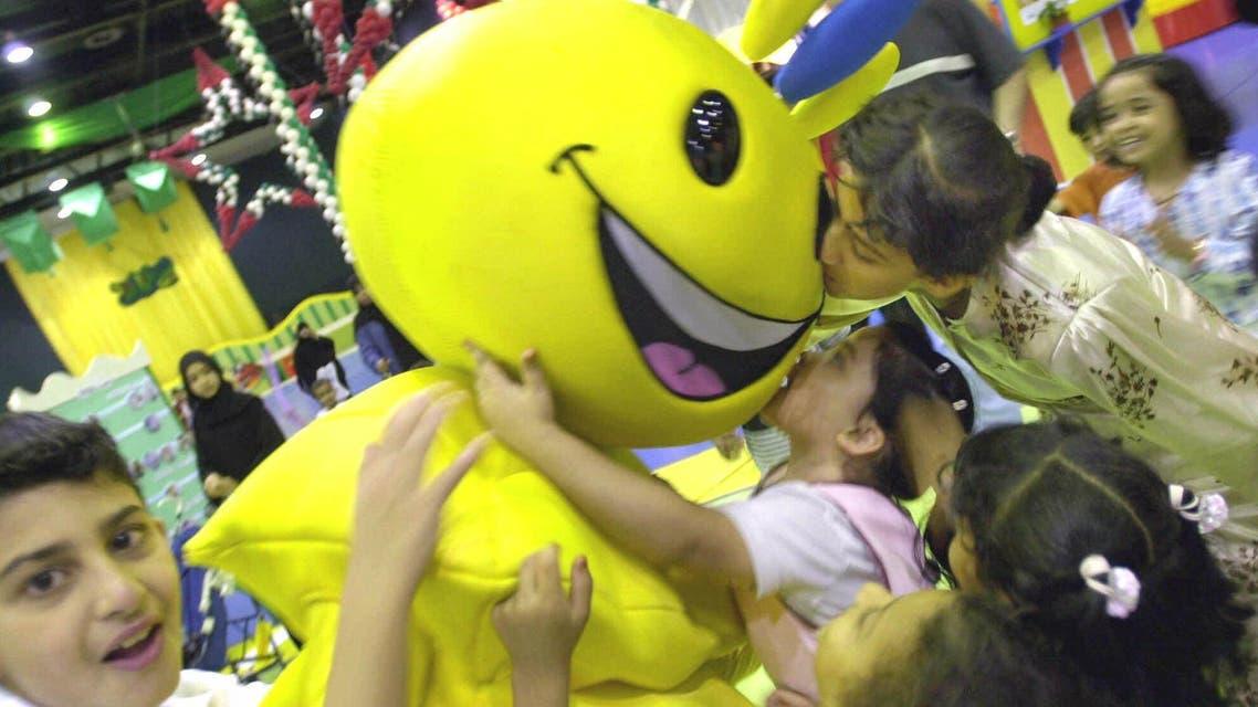 File photo of Arab children playing with Modhesh, the cartoon character at the Modhesh Fun City during Dubai Summer Surprises (AP)