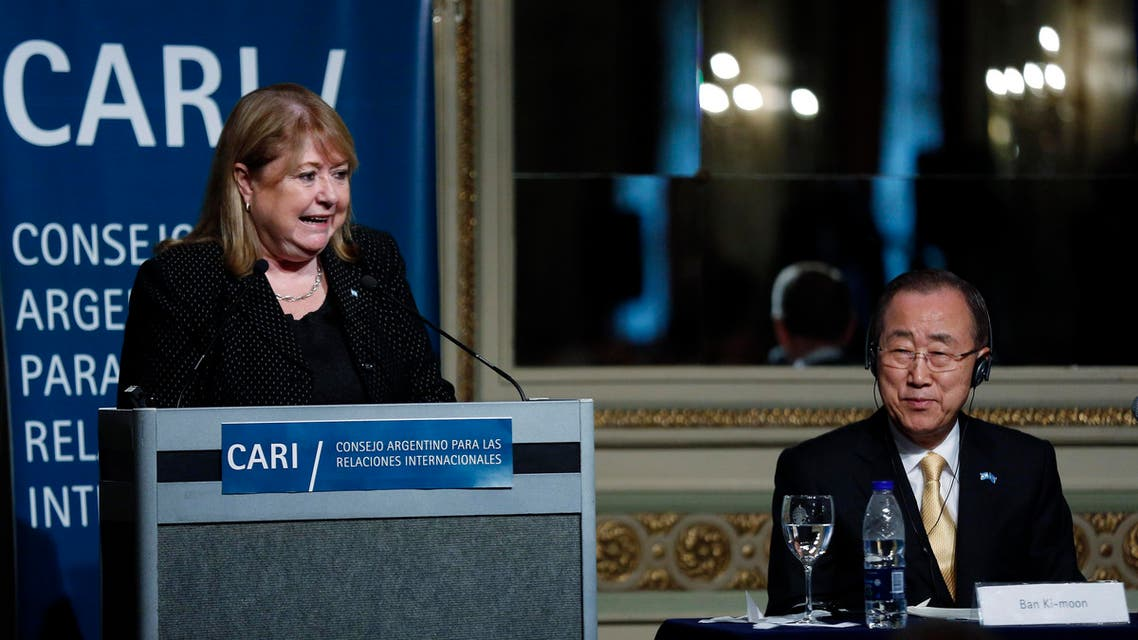 United Nations Secretary-General Ban Ki-moon listens as Argentina's Foreign Minister Susana Malcorra delivers remarks during a conference at the Argentine Council for International Relations or CARI, in Buenos Aires,