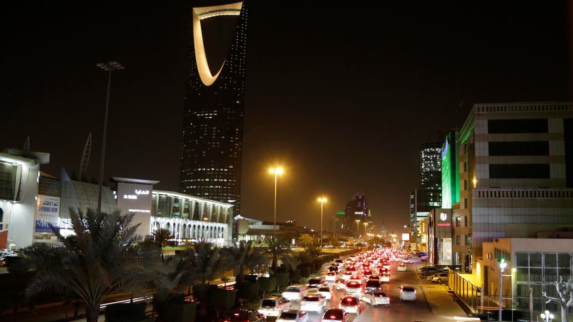 File photo of traffic passing by the Kingdom Tower  in Riyadh. (AP)