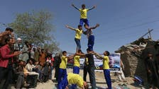 Afghan acrobats bring smiles to displaced children's faces
