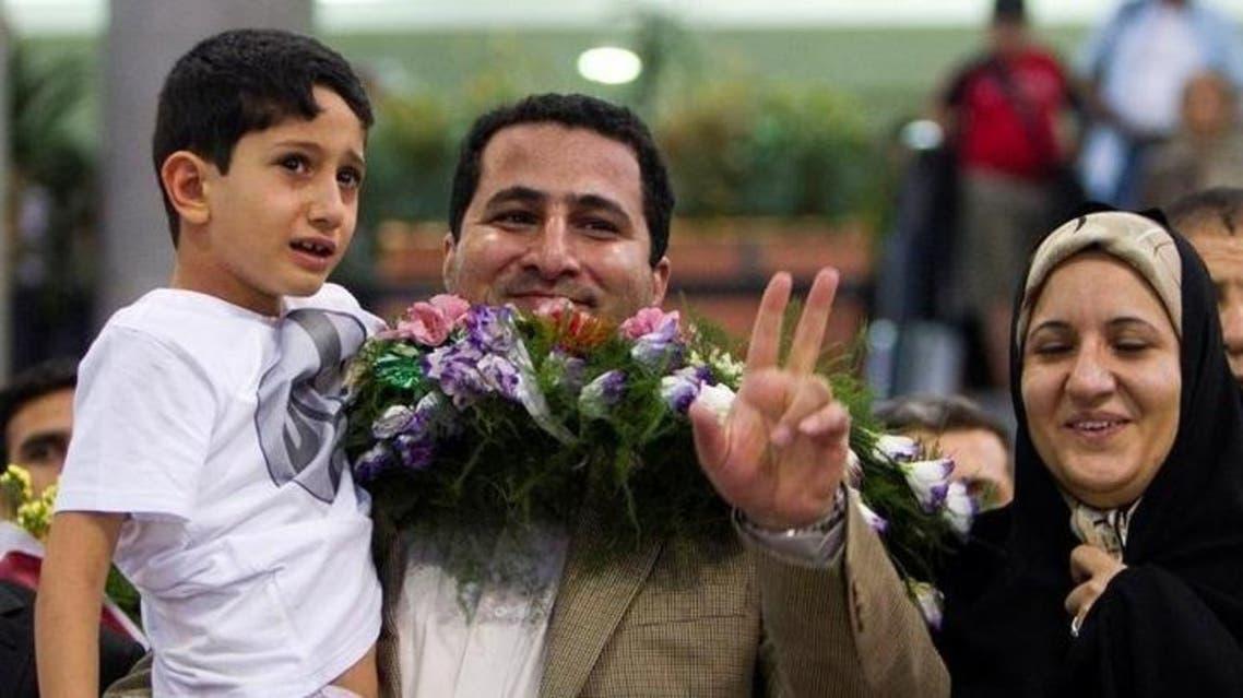 العالم النووي الإيراني شهرام أميري في مطار الخميني في طهران - رويترز