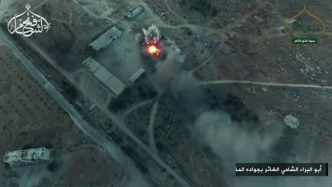 A still from drone footage by Al-Nusra Front showing smoke billowing from an artillery school south of Aleppo as Islamist rebels captured two military academies and a third military position – August 6, 2016. (AFP)