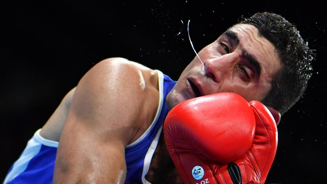 Waheed Abdulridha receives a punch from Mexico's Uziel Rodriguez in the Rio boxing tournament on August 9. (AFP)