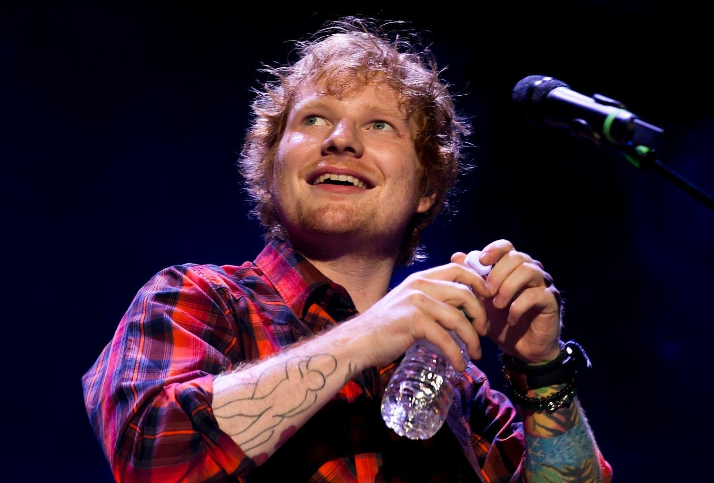 Ed Sheeran performing at a concert AP