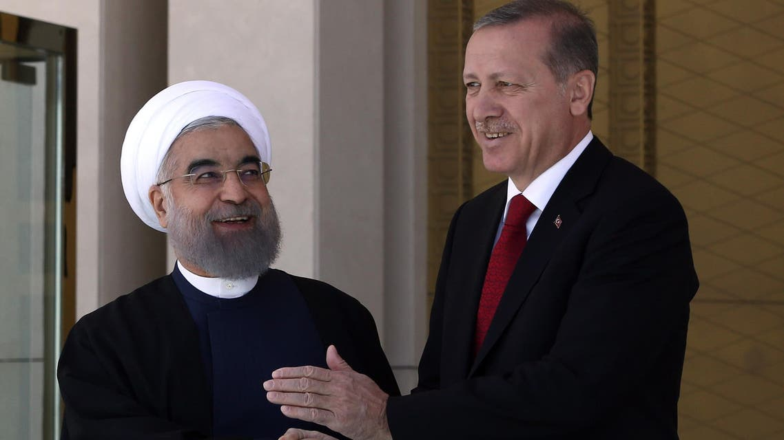 Turkey's President Recep Tayyip Erdogan, right, and Iran's President Hassan Rouhani shake hands during a welcome ceremony in Ankara, Turkey, on April 16, 2016. (AP)