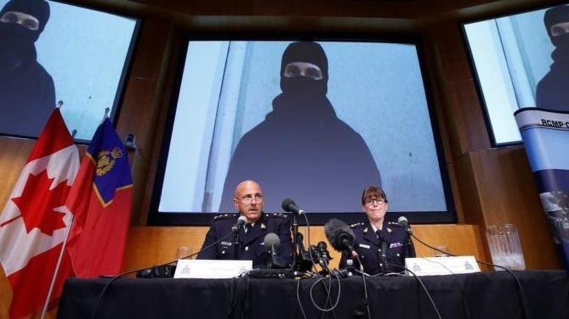 A video of Aaron Driver, a Canadian man killed by police on Wednesday who had indicated he planned to carry out an imminent rush-hour attack on a major Canadian city, is projected on a screen during a news conference with Royal Canadian Mounted Police (RCMP) Deputy Commissioner Mike Cabana (L) and Assistant Commissioner Jennifer Strachan in Ottawa, Ontario, Canada, August 11, 2016. reuters