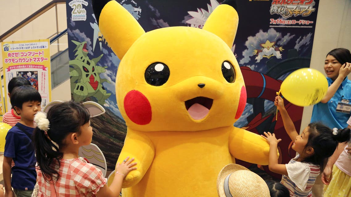 Pokemon character, is surrounded by children during a Pokemon festival in Tokyo. (File Photo:AP)