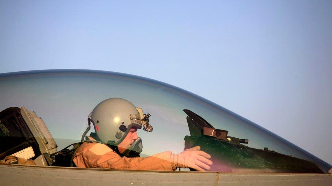 In this Thursday, June 21, 2007 file photo, U.S. Air Force Capt. Shaun Germain, 26, from Lindstrom, Minn. prepares to pilot his F-16 Falcon aircraft at Balad Air Base, 50 miles north of Baghdad, Iraq. (AP)