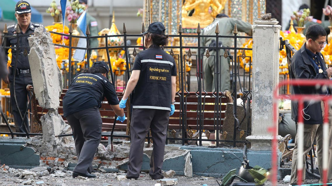 Police investigate a scene the morning after an explosion in Bangkok,Thailand, Tuesday, Aug. 18, 2015. AP
