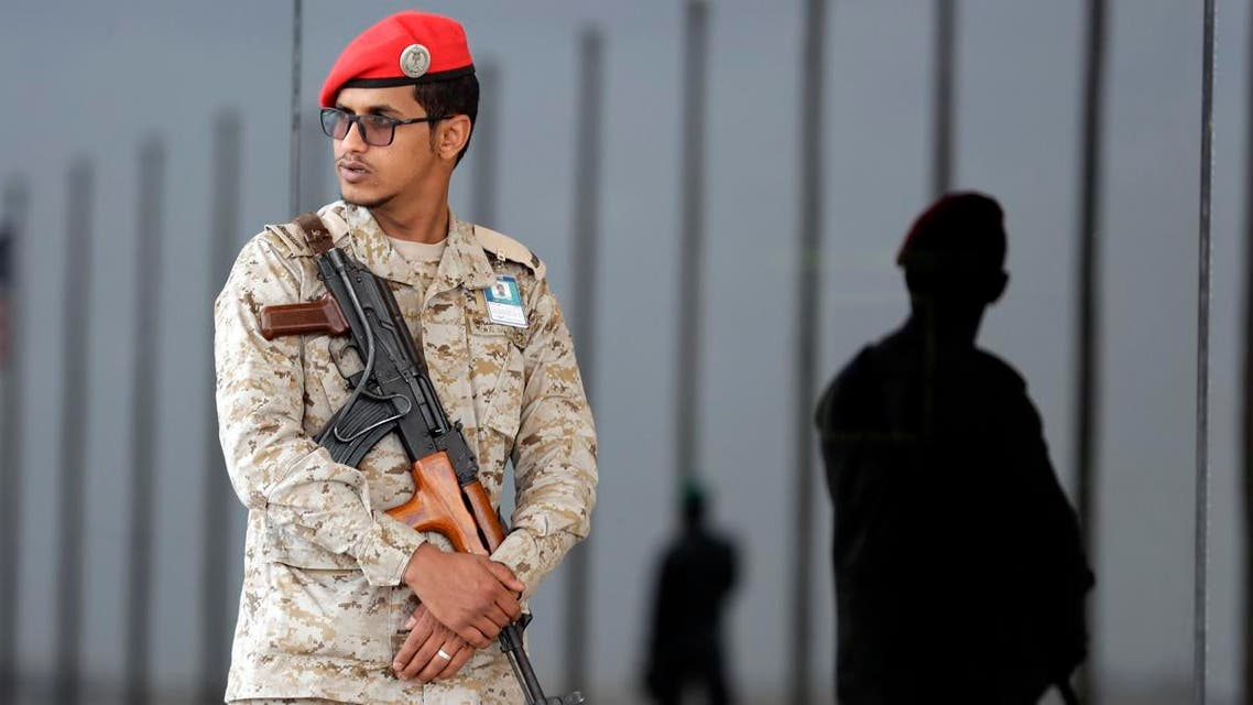 Saudi soldier stands guard AP