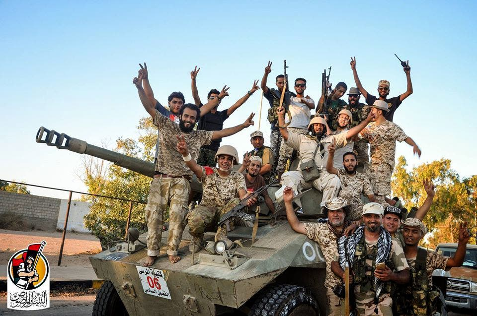 U.S.-backed forces celebrate re-taking Sirte, Libya from the Islamic State group Thursday, Aug. 11, 2016. AP