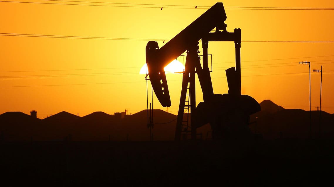 A pumpjack sits on the outskirts of town at dawn in the Permian Basin oil field on January 21, 2016 in the oil town of Midland, Texas. (AFP)