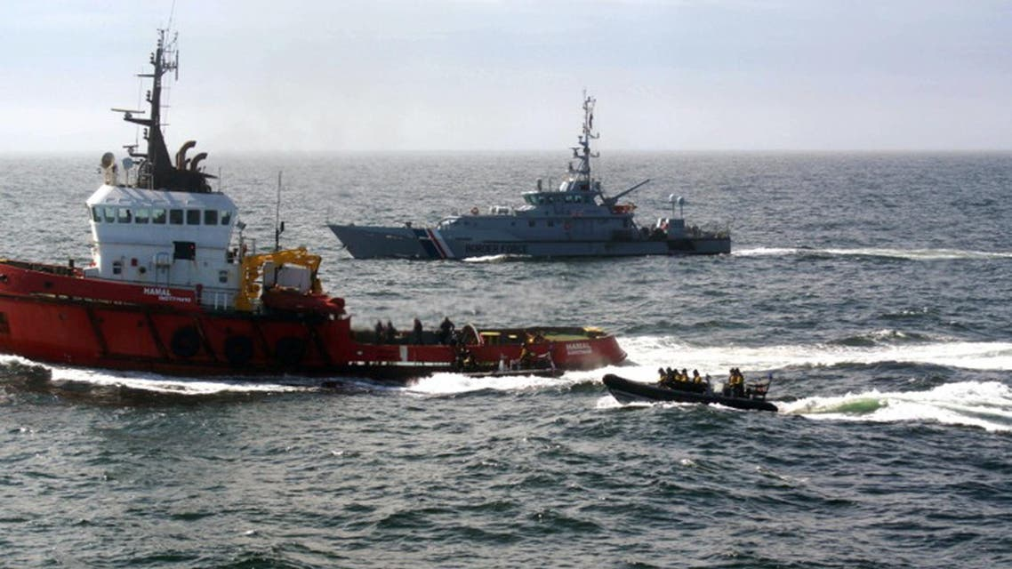 This file photo taken on April 26, 2015 shows a handout photograph taken and released on April 25, 2015 by Britain's National Crime Agency (NCA) showing Border Force cutter Variant (C) intercepting the tug Hamal, believed to have been carrying a shipment of cocaine, as it traveled 100 kilometres (60 miles) off the east coast of Scotland. (AFP)